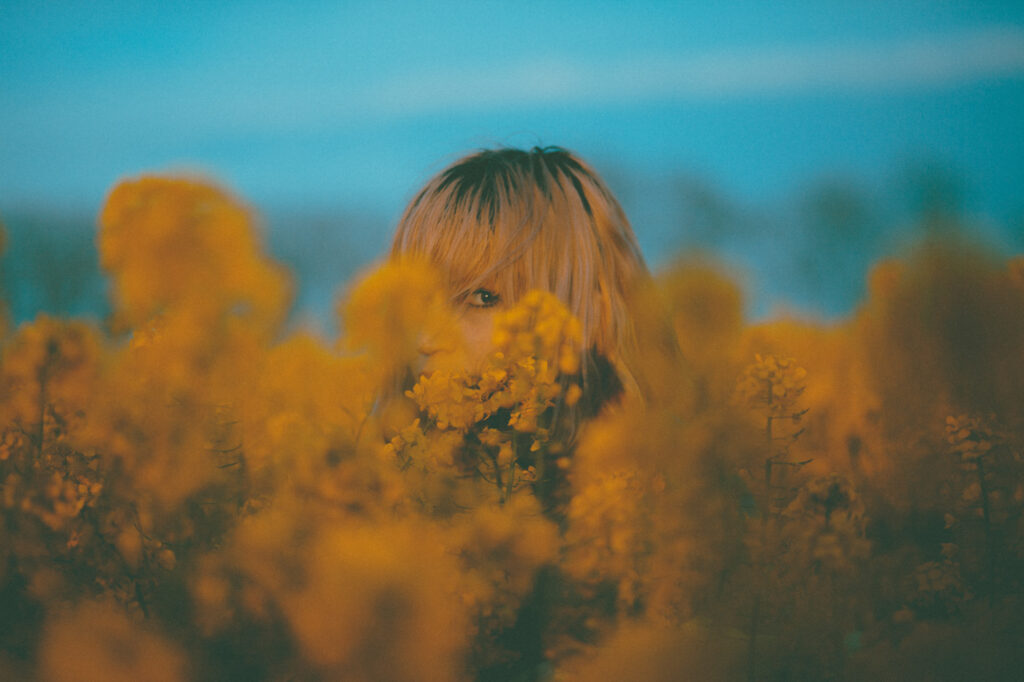 Jennifer in a yellow field at sunset, 2016